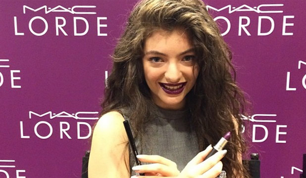 BESPOKE LIPPIE: Lorde showing off her M.A.C. lip shade Pure Heroine. We love it, but it's certainly not for the faint of heart.