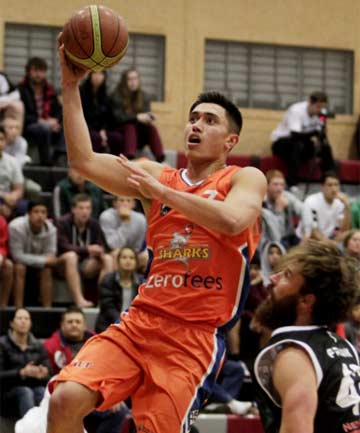 ONE-HANDED EFFORT: Southland Sharks player Reuben Te Rangi heads for the basket in his team's National Basketball League win over the Waikato Pistons in Hamilton.