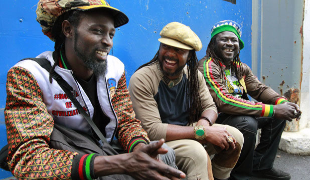 DAY OF COLOUR: Performers Lamine Sonoko, left, Bohemian Thought and King Marong at Africa Day held at Shed 6, Wellington waterfront.