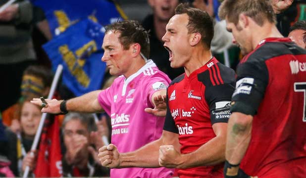 DENIED: Referee Glen Jackson signals 'no try' as Crusaders fullback Israel Dagg celebrates at the end of their victory over the Highlanders.