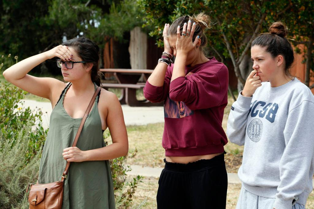 UC Santa Barbara students react near one of the crime scenes after series of drive-by shootings.