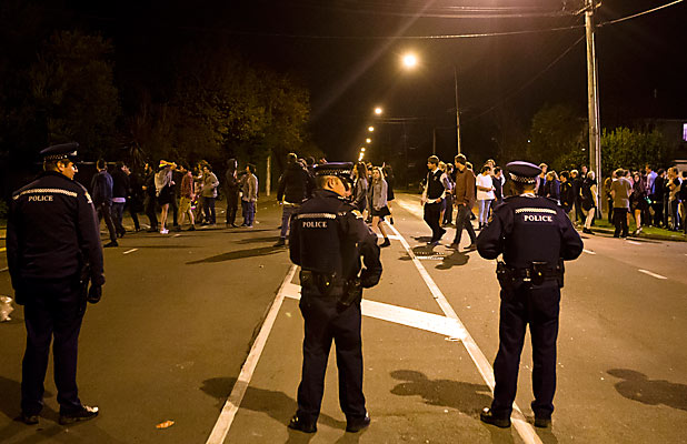 CLEARING OUT: Police move on hundreds of partygoers from an address on Hansons Ln on Saturday.