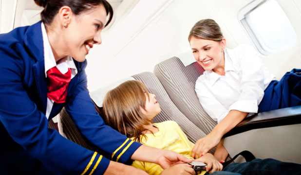 FLYING WITH KIDS: Some kids are peaches, quietly drawing away and watching movies, hardly making a peep.
