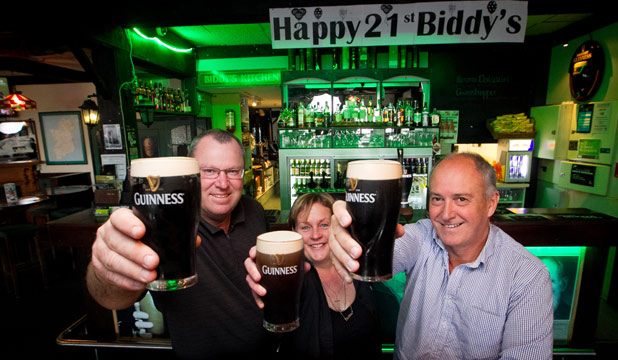 A STOUT CREW: The team at Biddy Mulligan's toast the pub's 21st birthday, from left: Duncan Otto, Maddy Barker and Mark Flyger.