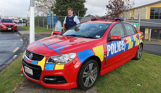 HIGH VISIBILITY: Inspector Richard Middleton, who is retiring after 33 years service, with the new red highway patrol car will be out in force this Queen's Birthday Weekend.