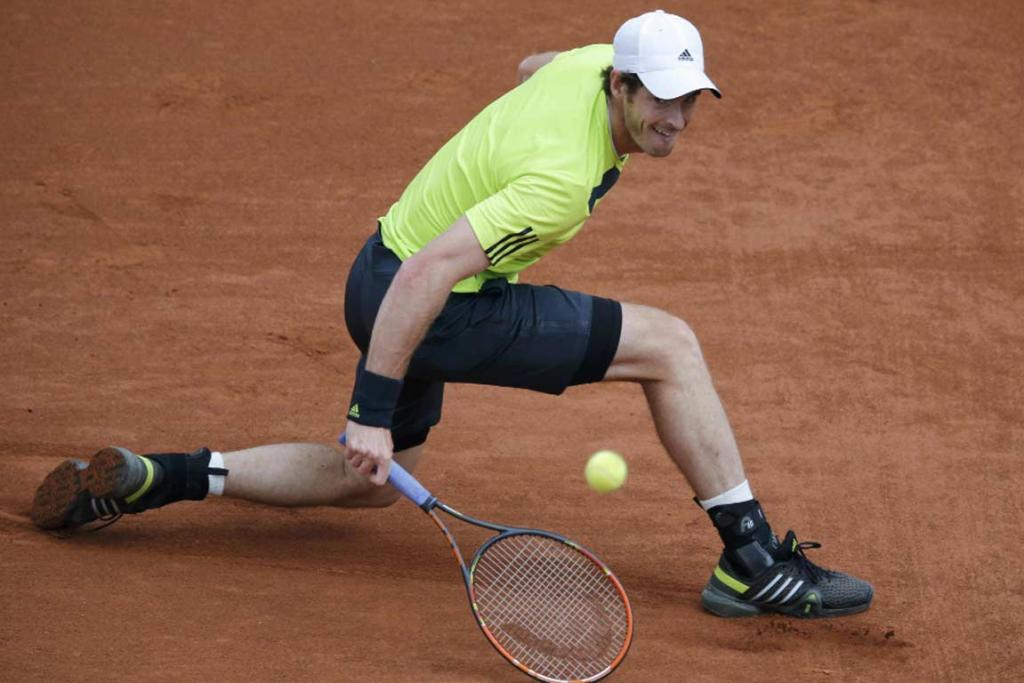 Andy Murray stretches for a backhand during his first round match against Andrey Golubev of Kazakhstan.