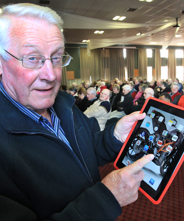 PULL CREDIT: Robin Criglington, 71, gets to grips with internet banking on his iPad at a seminar in Invercargill.