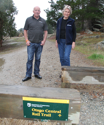 TRAIL CELEBRATION: Commonwealth Games 10,000m gold medallist Dick Taylor and Otago Central Rail Trail Trust founding member Daphne Hull stand on the trail in Alexandra.