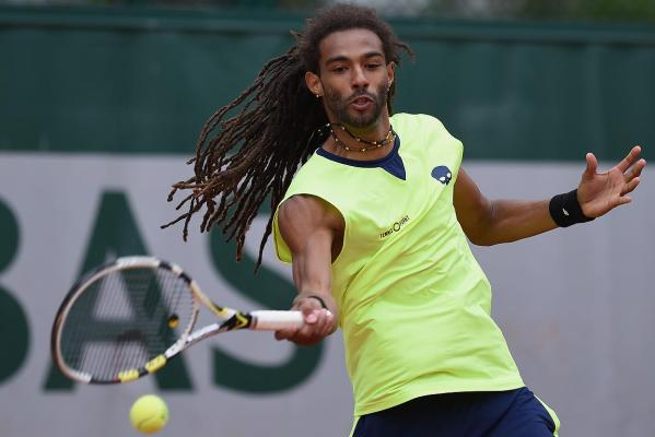 Dustin Brown of Germany returns a shot during his men's singles match against Marinko Matosevic of Australia on day three of the French Open.