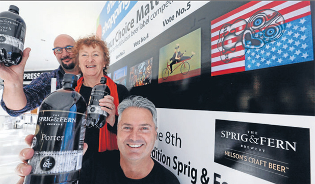 START VOTING: Fresh Choice supermarket owner Mark A'Court, left, Annie Leather and Nic Foster with the finalist artworks, one of which will go on bottles of Sprig and Fern beer.