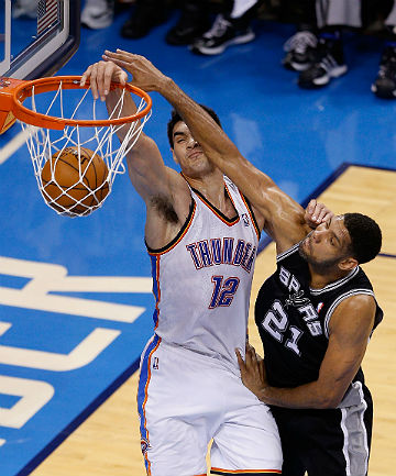 HIGH JUMP: Steven Adams of the Oklahoma City Thunder drives to the basket against Tim Duncan of the San Antonio Spurs.