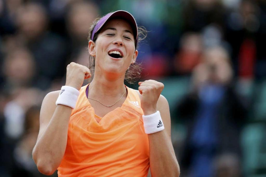 Spain's Garbine Muguruza celebrates her upset victory over No 1 seed Serena Williams.
