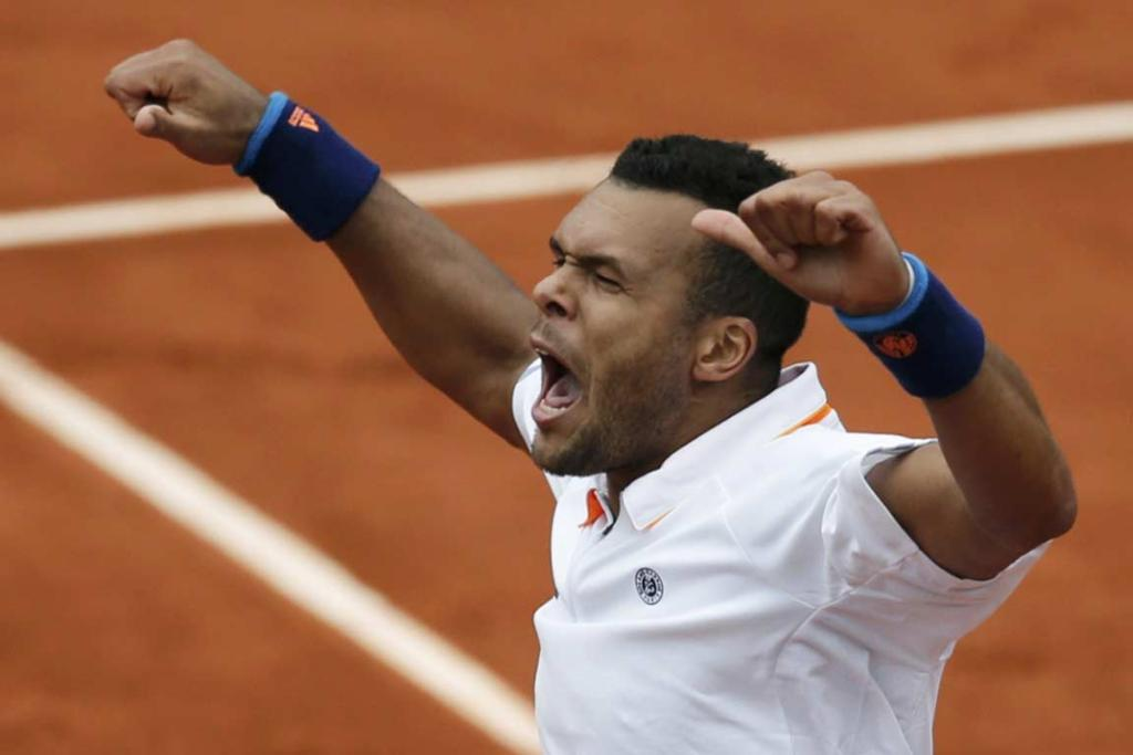 Frenchman Jo-Wilfried Tsonga celebrates his victory over Jurgen Melzer.