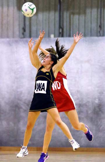 REACHING HIGH: New Plymouth Old Boys wing attack Jessie Aitken-Fowell goes up to with Sacred Heart Girls' College wing defence Kate Wells in a Taranaki premier one netball game in Stratford.