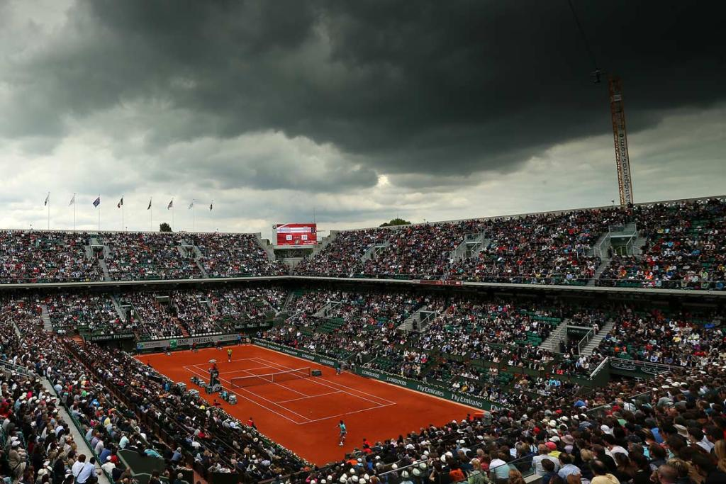 Dark clouds hover over the Philippe Chatrier Court as Rafael Nadal plays Dominic Thiem.