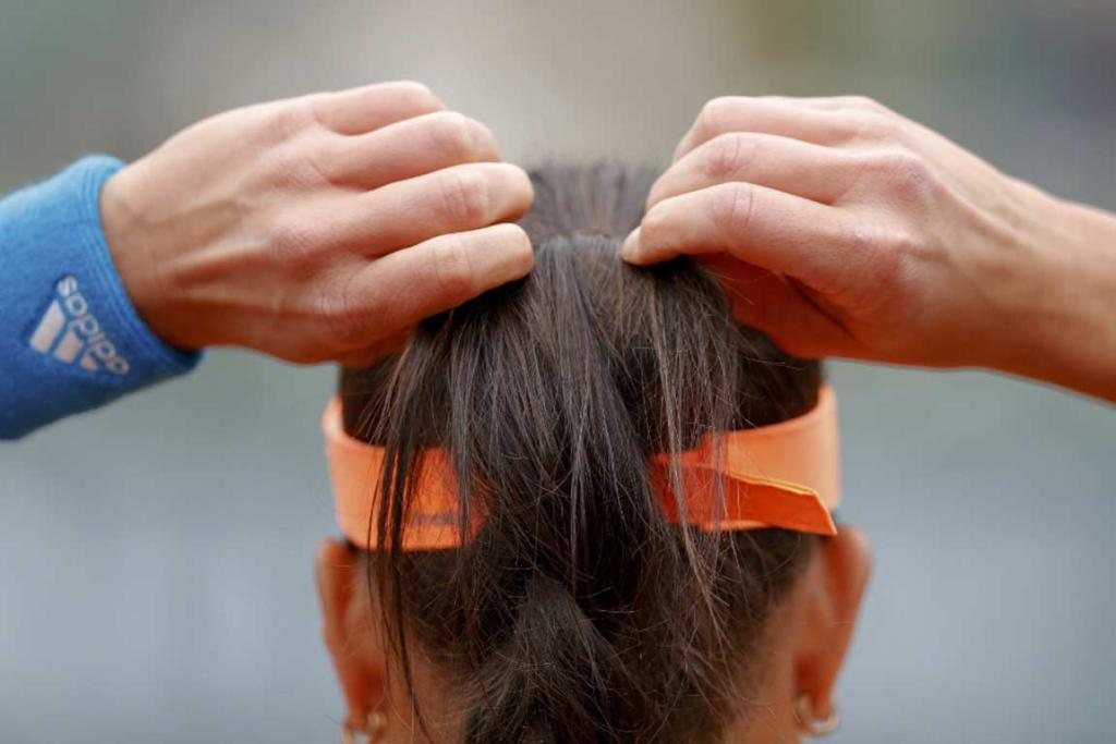 Ana Ivanovic adjusts her ponytail while playing Ukraine's Elina Svitolina.