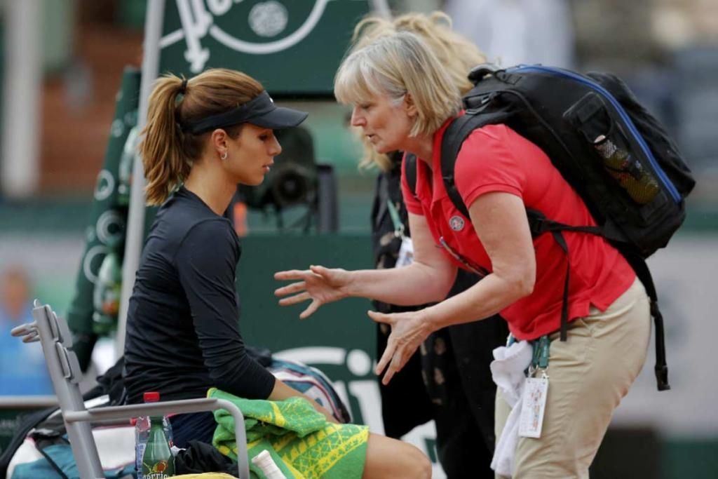 Tsvetana Pironkova receives advice from a medical staffer during her loss to Maria Sharapova.