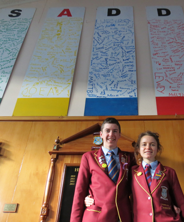 DOING WELL: Roncalli College wellbeing leaders Lachie Scarsbrook and Sophie Newmarch in front of the SADD (Students Against Dangerous Driving) pledges boards the whole school signed.