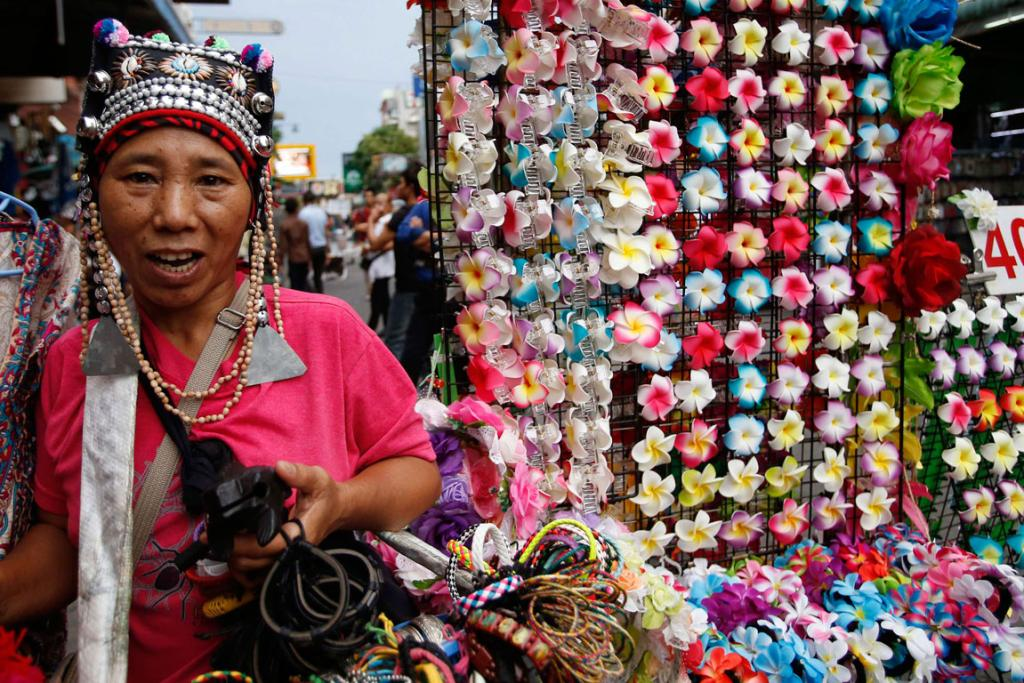 A vendor selling trinkets waits for customers in a tourist district of Khao San Road in Bangkok.