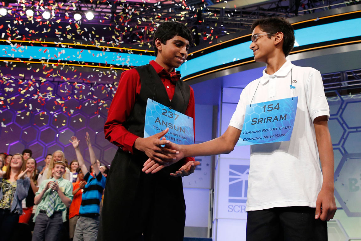 Ansun Sujoe, left, of Texas shakes hands with co-winner Sriram Hathwar