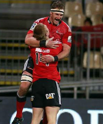 GOOD JOB BRO: Returning Crusaders No 8 Kieran Read celebrates with winger Johnny McNicholl after the latter scored a try.