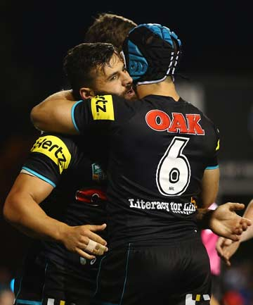 TOO EASY: Josh Mansour (left) gets a hug from a team-mate after one of his two tries in Penrith's 38-12 demolition of Parramatta.