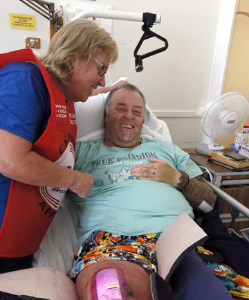 SLOWLY HEALING: Stephen Sowman, recovering in Nelson Hospital, shares a laugh with his sister Andrea Wallace. He has months of recovery ahead of him as he heals from his injuries.