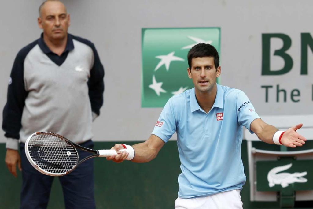 Novak Djokovic questions a line call during his four-setter against Croat Marin Cilic.