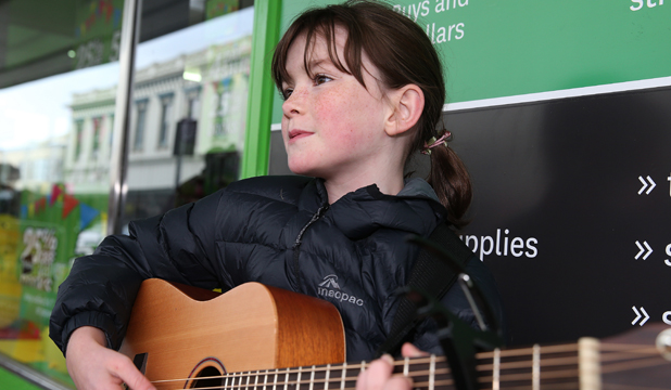 BIT OF BUSKING: Nicola Mitchell, 10, of Gore, competes at The Freeze Ya Bits Off Busking competition, which is held as part of the New Zealand Gold Guitar Awards.