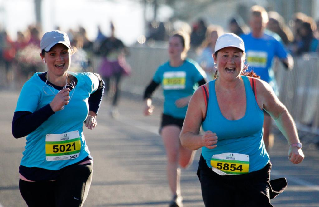 Runners blasting towards the finish line in the Christchurch airport marathon.