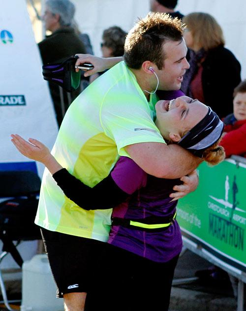 Christchurch airport marathon runners relieved after crossing the finish line.