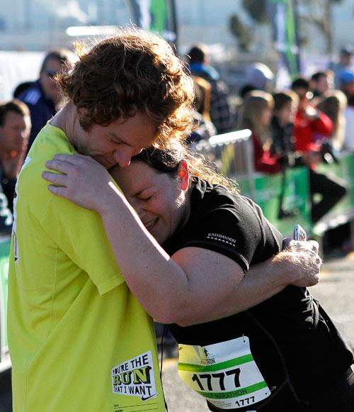Christchurch airport marathon runner welcomed with open arms after crossing the finish line.
