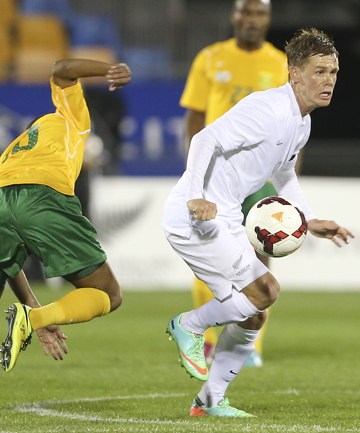 QUALITY OPERATOR: All Whites midfielder Michael McGlinchey goes past South Africa's Thulani Serero during Friday's international in Auckland.