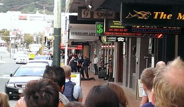 STANDSTILL: Crowds gather as police deal with a man on Courtenay Place.