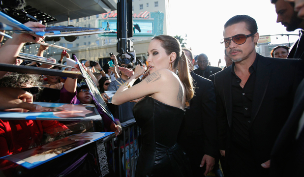 STARS: Angelina Jolie and Brad Pitt spend time with fans before the premiere of her movie, Maleficent.