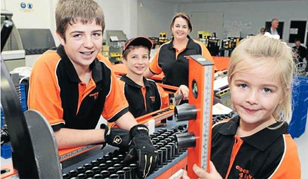 Matamata inventor Patrick Roskam, 13, with mum Angela, brother Edward, 11, and sister Victoria, 5, work together to on the production line of his tool.
