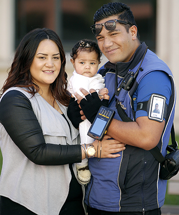 FAMILY TIME: Esau Taniela will have more time at home with wife Shalanei and daughter Cascade when parking wardens will become Wellington City Council employees, qualifying him for a living wage.