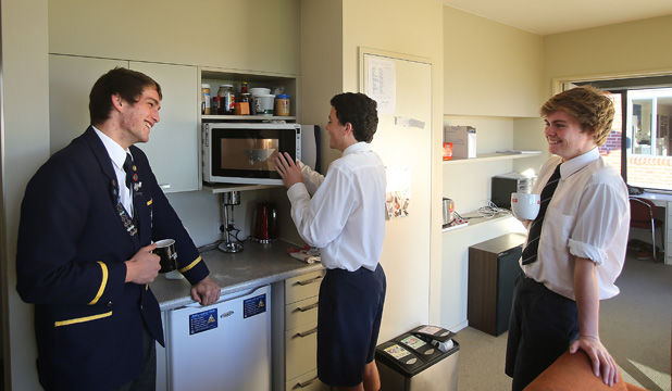 COMPETITIVE PLACES: Timaru Boys' High School boarders, Marc Palmer, left and Tim Colson a enjoy the facilities at Thomas House. Boys' High is one of the South Canterbury boarding schools to already have a waiting list for next year.