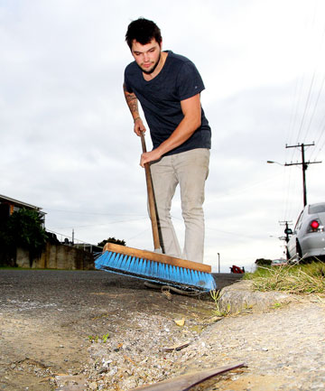 Jesse Byers cleans up the mess vandals made on Pioneer Rd.