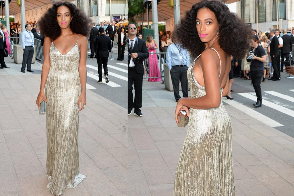 THE GOOD: This is like something big sis Beyonce would wear: Solange's style is usually more patterned Miu-Miu, but this silver silk Calvin Klein is a nice change. I love the pink lip.