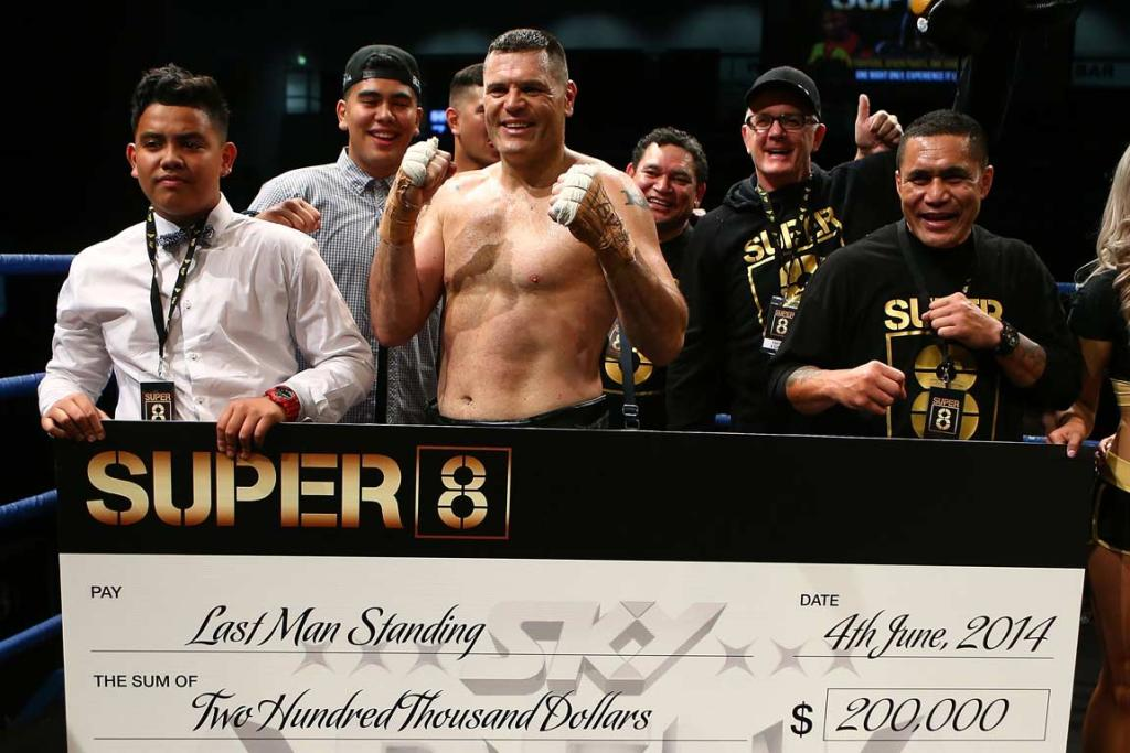 Kali Meehan and his cornermen with the Super8 winner's cheque.