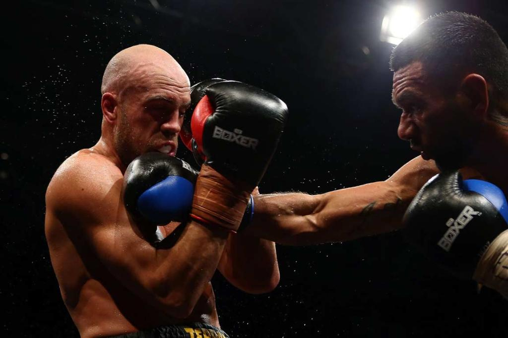 Sam Rapira takes a punch on the chin from Tai Rautere.