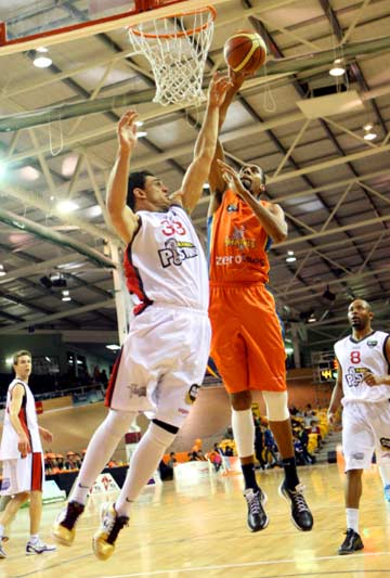 LENDING A HAND: Puke Lenden (left) playing for the Waikato Pistons against the Southland Sharks in 2011, has been signed to play for the Sharks.