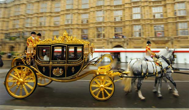 NEW RIDE: Queen Elizabeth II, accompanied by Prince Philip, arrives in the new Diamond Jubilee State Coach, to deliver her speech for the State Opening of Parliament in the House of Lords at the Palace of Westminster.