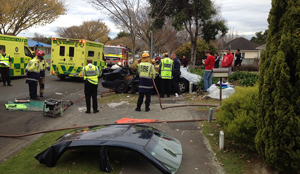 SCENE: Emergency services and witnesses at the scene of the Vogel St car crash.