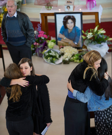MEMORIAL: Family and friends gather to remember the Auckland woman.