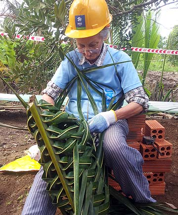 MUCKING IN: Tuakana Wichman works on a build site on her trip to Vietnam last year.