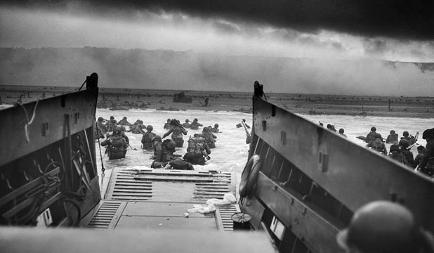 An iconic photograph of the D-Day landing at Omaha Beach, taken June 6, 1944, by a chief photographer's mate in the United States Coast Guard.