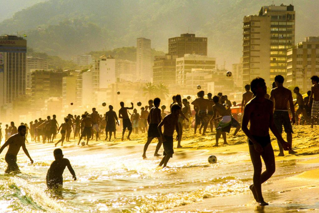 "Sunset on Ipanema beach to show the joy of cariocas (people from Rio de Janeiro) playing ""altinho"" soccer, a beach game in which the ball can't touch the sand."