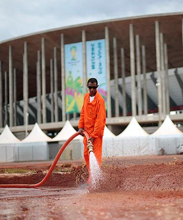 PREPARATIONS: A worker cleans outside the Mane Garrincha National Stadium ahead of the upcoming football World Cup in Brazil.